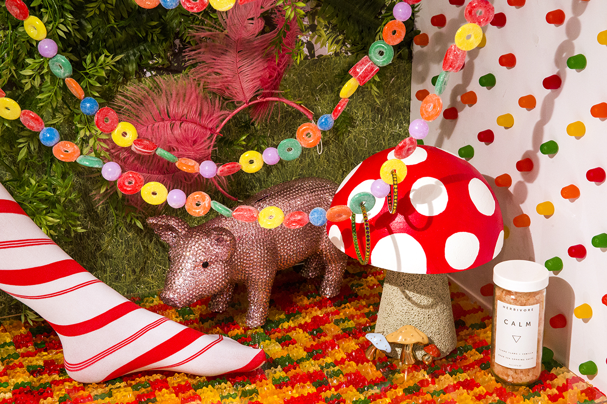 The Candy Room Balenciaga candy striped tights, Gift Boutique pig bank, Kurt S Adler Xmas candy garland, Alison Lou mushroom brooches, Roxanne Assoulin Swarovski crystal hoop earrings, Herbivore therapeutic bath salts