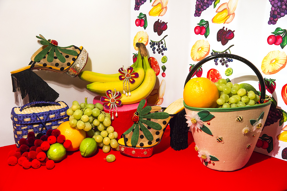 The Fruit Wallpaper Room Nannacay pompom clutch, Charlotte Olympia ladybug shoes, Shourouk red crystal earrings, Charlotte Olympia basket bag