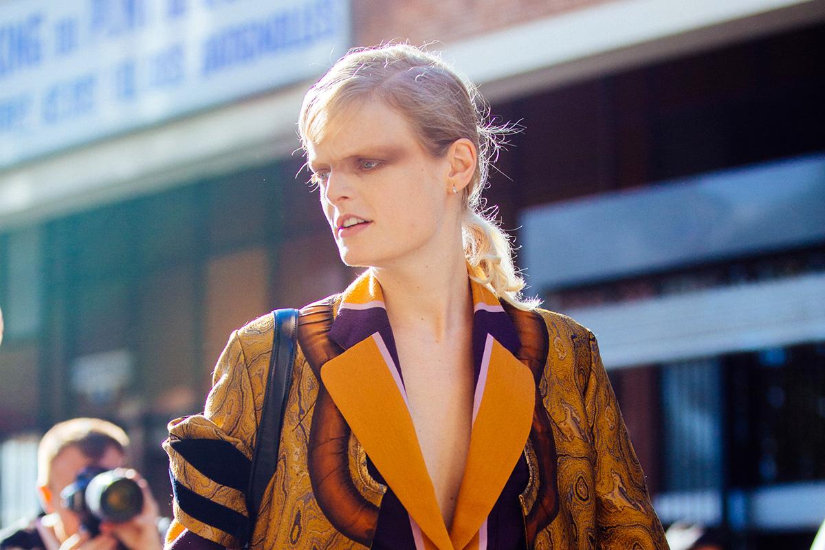 Belgian model Hanne Gaby wears an orange and purple bohemian Dries Van Noten outfit and keeps the dramatic dark eye makeup after the Dries Van Noten show on September 28, 2016 in Paris, France.
