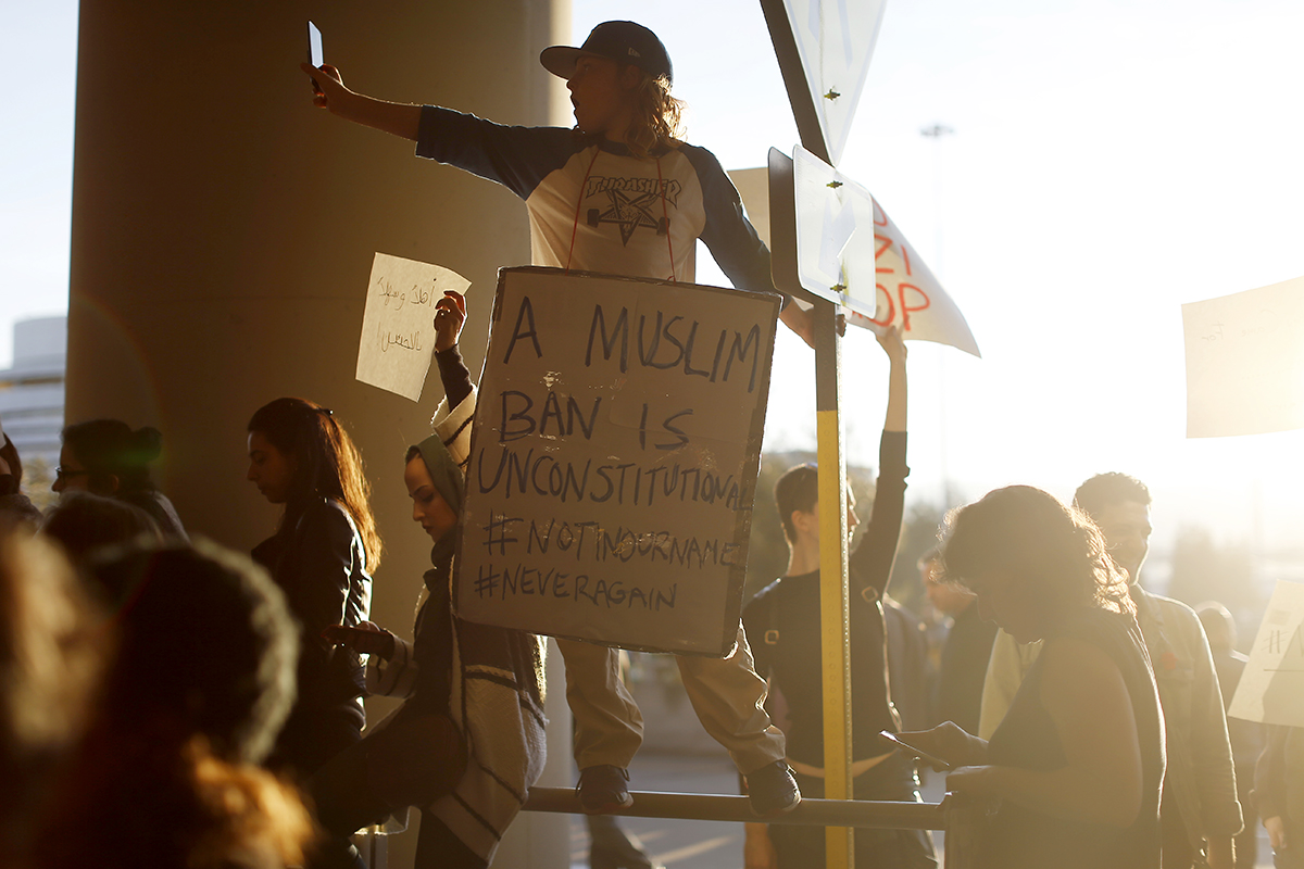 SAN FRANCISCO, CA - JANUARY 28: A demonstrator takes a photograph during a rally against muslim immigration ban at San Francisco International Airport on January 28, 2017 in San Francisco, California. President Donald Trump signed an executive order Friday that suspends entry of all refugees for 120 days, indefinitely suspends the entries of all Syrian refugees, as well as barring entries from seven predominantly Muslim countries from entering for 90 days. (Photo by Stephen Lam/Getty Images)