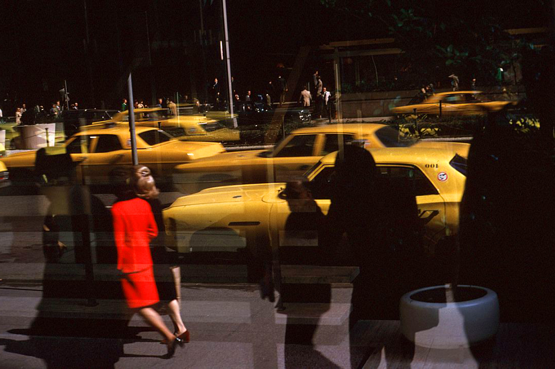 March 1971: Seen through a window yellow cabs fill a New York City street. (Photo by Ernst Haas/Ernst Haas/Getty Images)