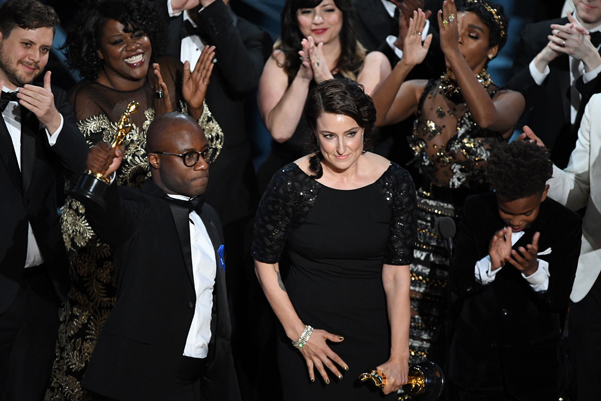 """TOPSHOT - US screenwriter Barry Jenkins celebrates after """"Moonlight"""" won the Best Film award at the 89th Oscars on February 26, 2017 in Hollywood, California. / AFP / Mark RALSTON (Photo credit should read MARK RALSTON/AFP/Getty Images)"""