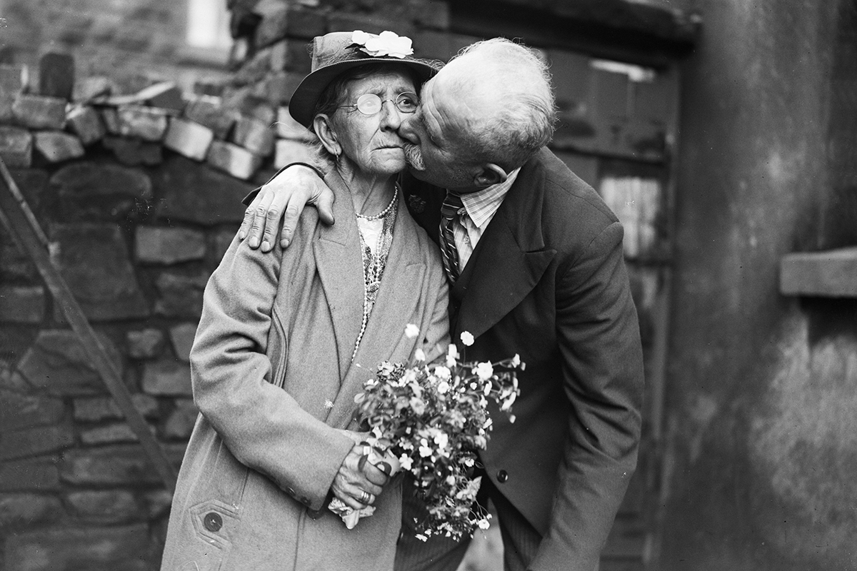 26th July 1936: 76 year old Evan Ellis of Anglesey kissing his bride, 70 year old Mary Ann Kinsley after their wedding at Ton Pentre, Rhondda. (Photo by Richards/Fox Photos/Getty Images)