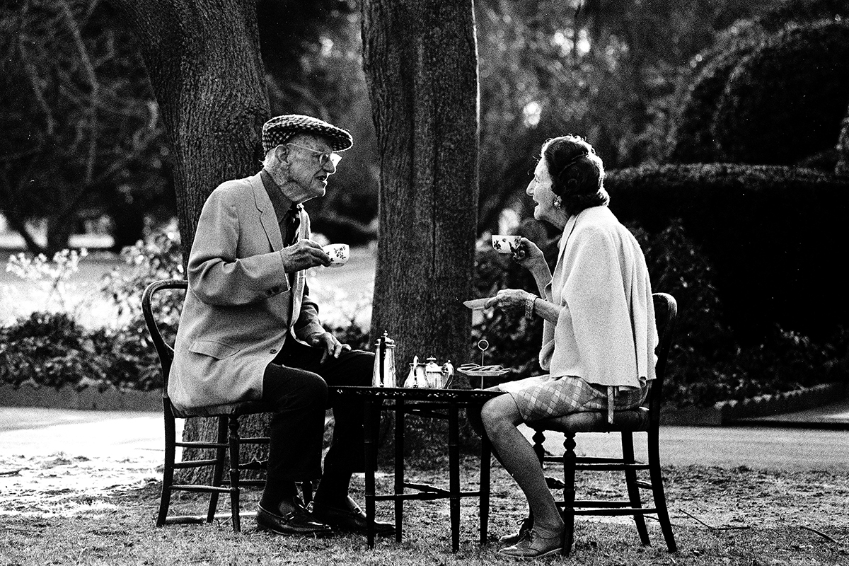 English writer Sir Pelham Grenville Wodehouse, KBE, aka P. G. Wodehouse, takes tea with his wife Ethel in Remsenburg, New York State, 14th December 1974. The great humorist had just been informed of the KBE (Knight Commander of the British Empire) bestowed on him by Her Majesty Queen Elizabeth II. (Photo by Michael Brennan/Getty Images)