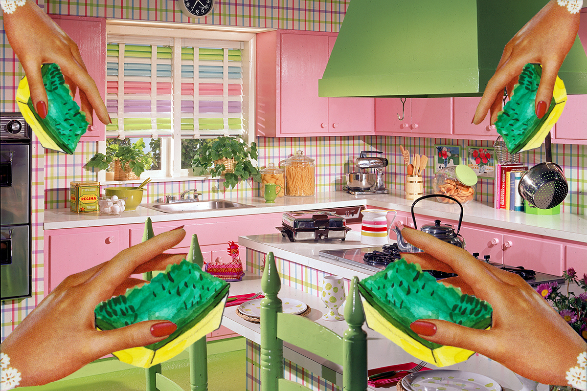 A model kitchen in pink and green with green, red, purple, and blue plaid walls and ceiling features hooded stove, a dining surface, pink cabinets, jars of pasta and cookies, and a clock reading 7:21, 1970s. (Photo by Hulton Archive/Getty Images)