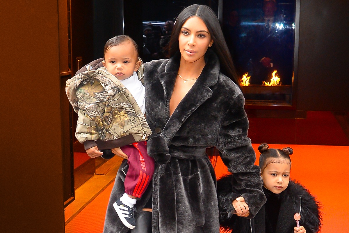 NEW YORK, NY - FEBRUARY 01: (L to R) Saint West, television personality Kim Kardashian West, and North West leave their Midtown Manhattan hotel on February 1, 2017 in New York City. (Photo by Raymond Hall/GC Images)